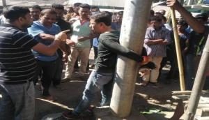 Assam journalist tied to pole, thrashed in public