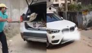 अपनी BMW कार से कूढ़ा ढो रहा रांची का ये युवक, वजह जानकर रह जाएंगे दंग