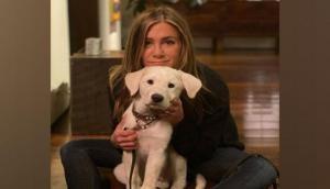 Jennifer Aniston cuddles up with pet dog on Thanksgiving: 'We're grateful'