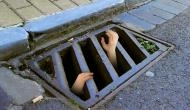 Man cries for 'help' after his girlfriend's brothers dumped him in a sewer