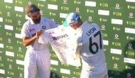Ajinkya Rahane presents signed Indian jersey to Nathan Lyon for completing 100th Test