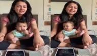 मां की गोद में बैठकर गाना गाता दिखा छोटा सा बच्चा, वीडियो देख मुस्कुराने लगेंगे आप