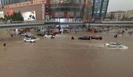 चीन में बाढ़ से भयंकर तबाही, अबतक 25 मौतें, कई लोगों को रेस्क्यू कर बचाया गया