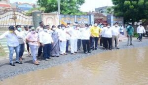 TDP leaders inspect potholes on roads in Andhra's Krishna, detain by police for traffic obstruction