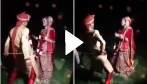 This bride and groom dancing like no one's watching; video goes viral