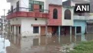 यूपी: प्रयागराज में गंगा-यमुना नदियां उफान पर, पानी में डूबे हजारों घर, सैकड़ों छात्रों का NDRF ने किया रेस्क्यू