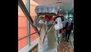 Hardeep Singh Puri receives 3 Swaroop of Sri Guru Granth Sahib brought from Kabul at Delhi airport