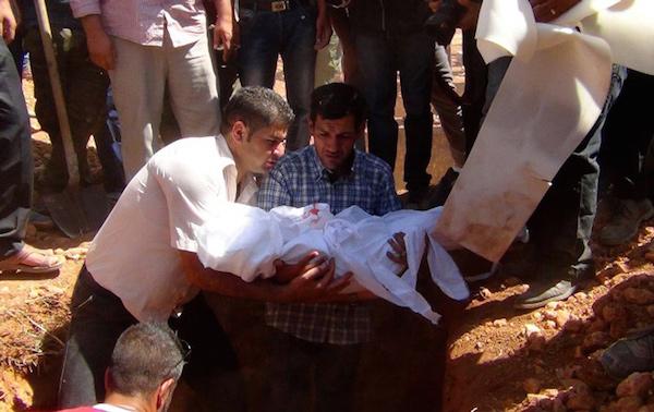 Aylan Kurdi Burial AFP PHOTO / ANHA