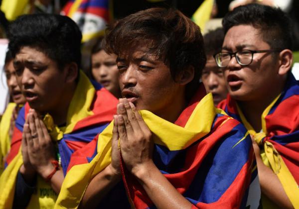 Photo: Tibetan Youth Protest(AFP PHOTO / SAJJAD HUSSAIN)