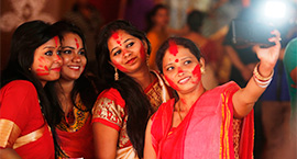 Paint the town red: Sindur khaela brings down the curtain on Durga Puja on a merry note