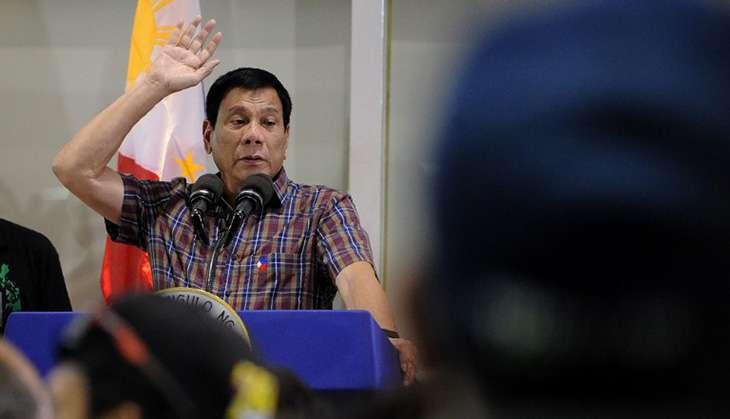 Philippine President Rodrigo Duterte speaks to ove