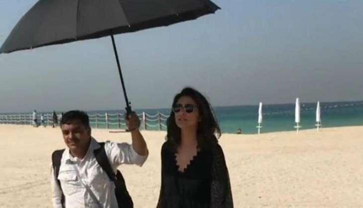 Parineeti Chopra and a man holding an umbrella for